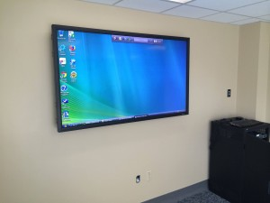 "70"" Display with Extron MLC 62 Wall Plate controller."